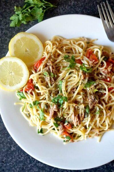 Overhead shoot of a white plate of tuna spaghetti