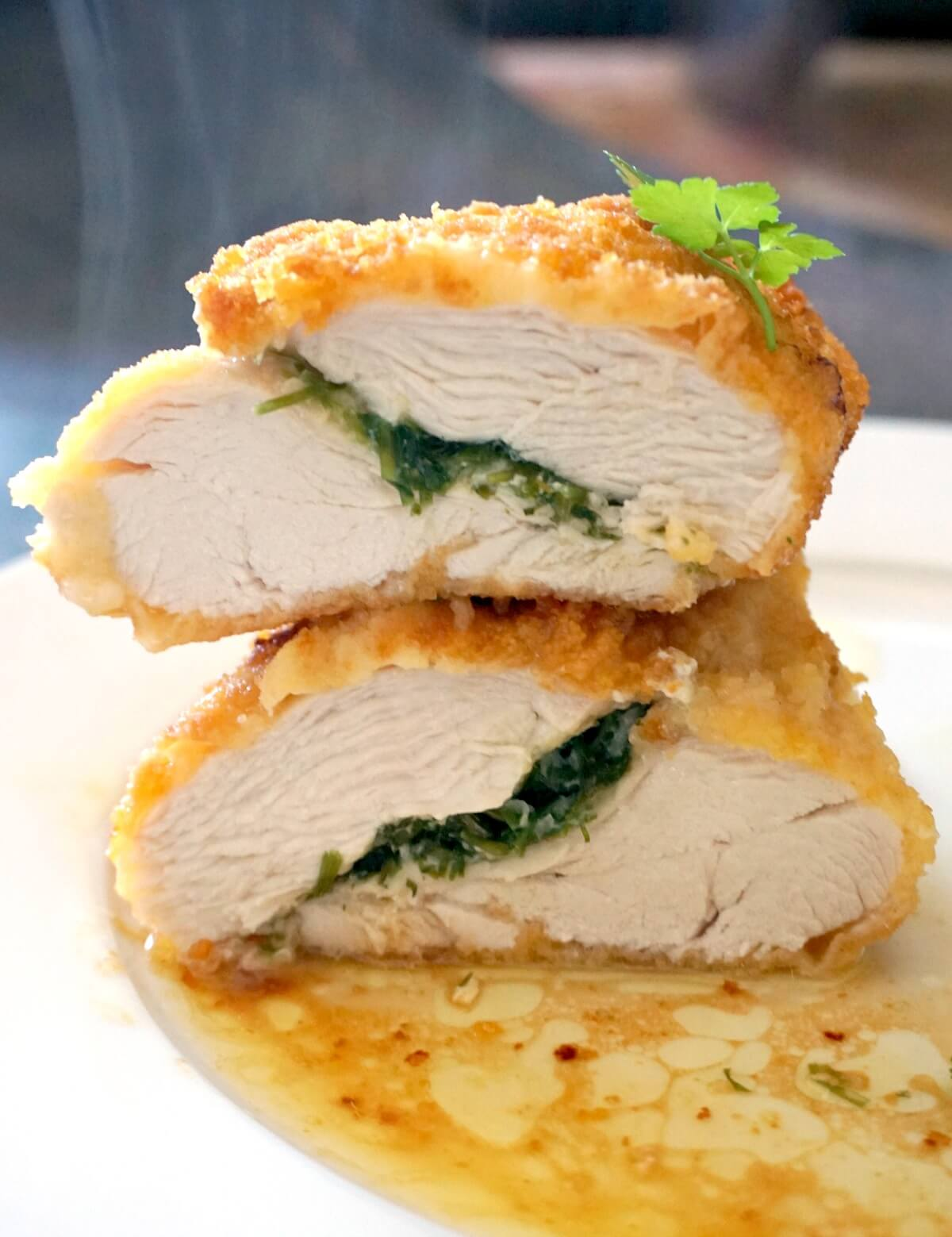 2 halves of chicken chicken kiev stacked on top of each other