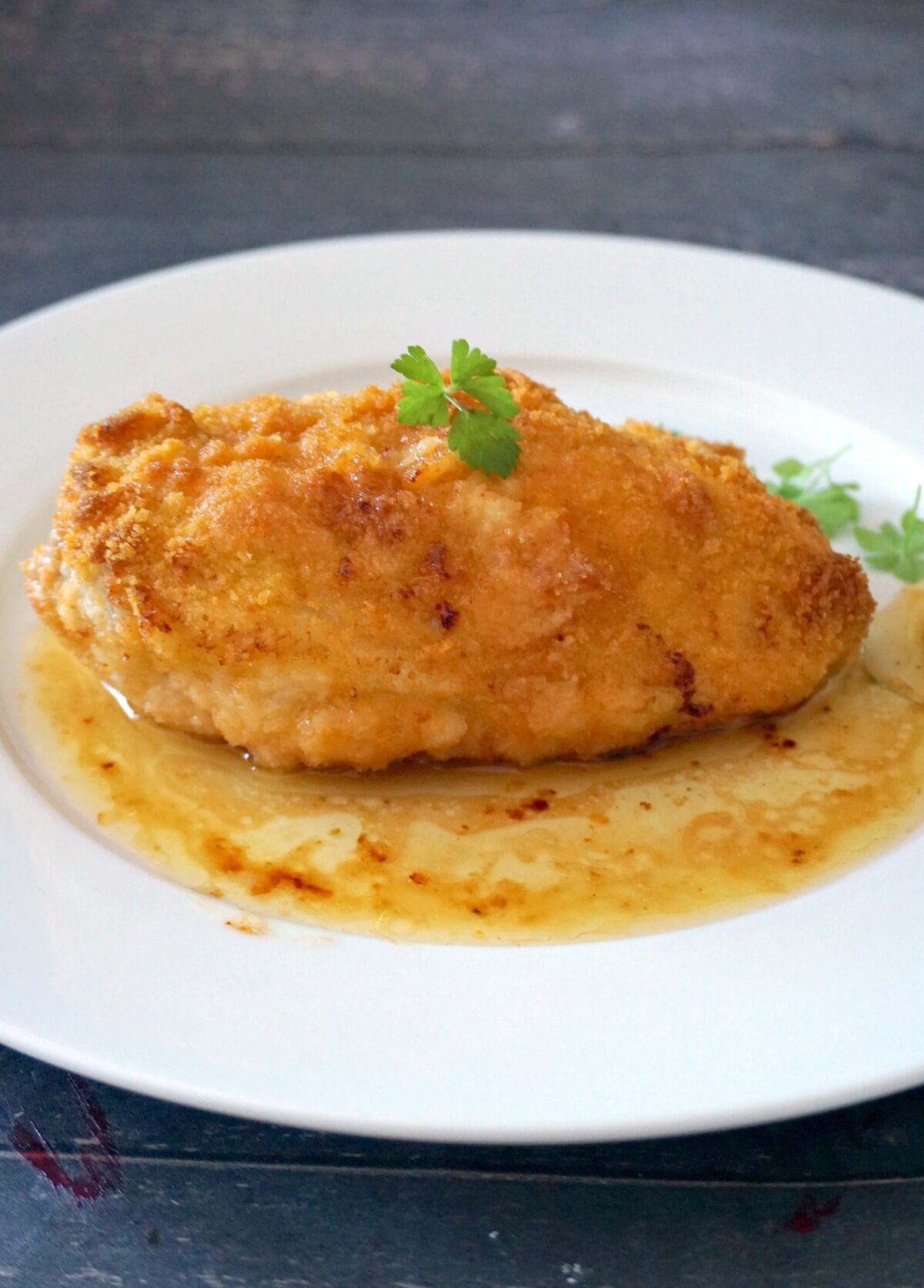 A chicken kiev on a white plate
