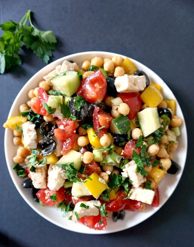 Overhead shoot of a white plate of Mediterranean Chickpeas Salad with Feta