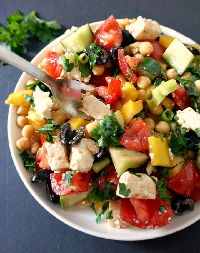 A white plate with Mediterranean Chickpea Salad with Feta