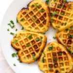 Overhead shoot of a white plate with 5 savoury cornbread waffles