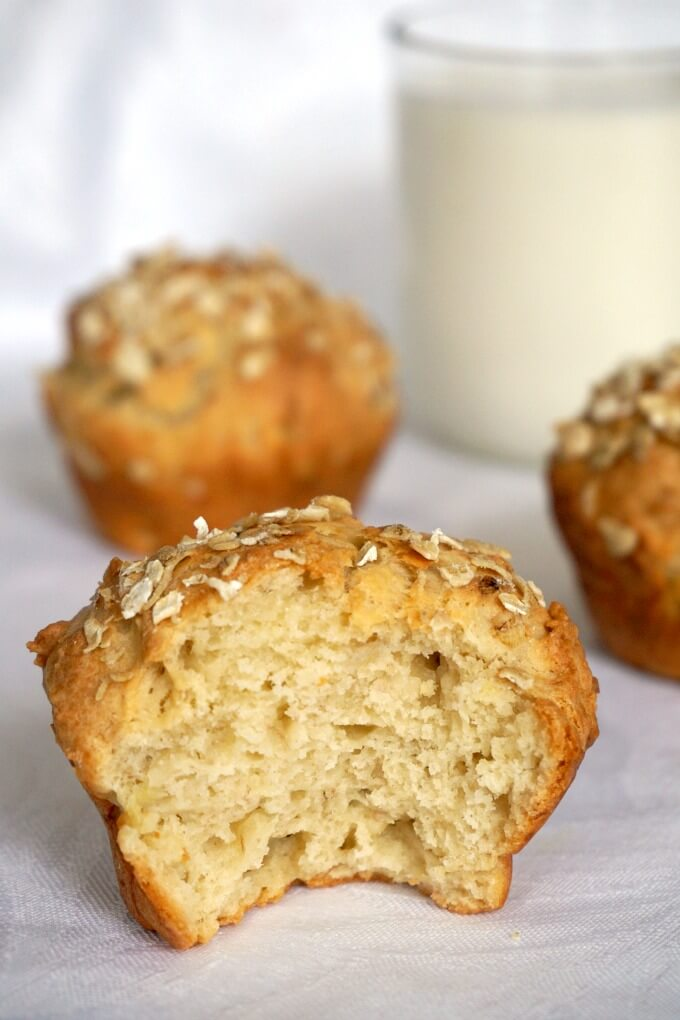 Half a banana muffin with other muffins in the backgroun