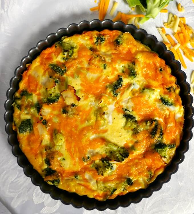 Overhead shot of a Low Carb Crustless Broccoli and Cheese Quiche in a tin pan