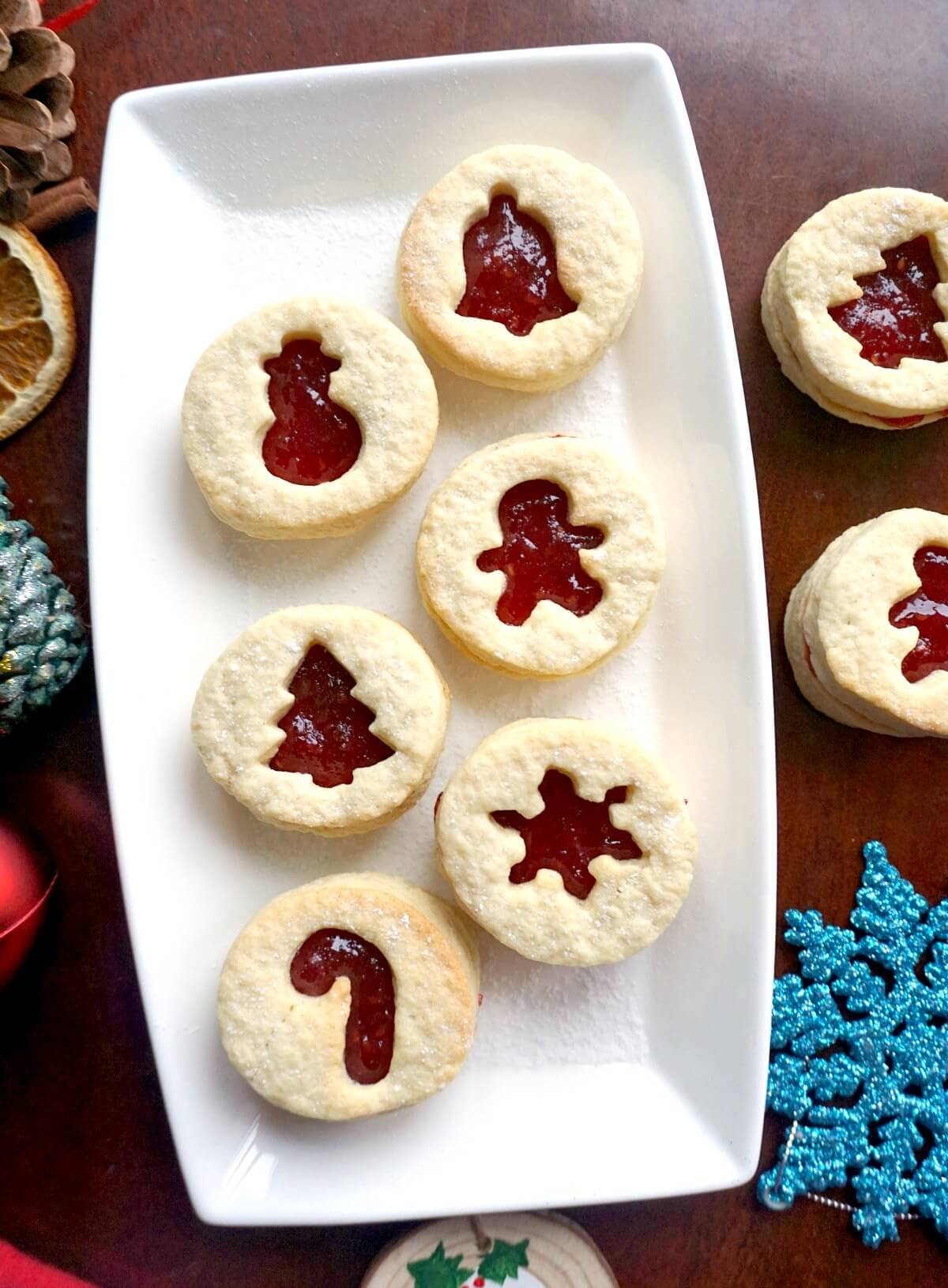 Overhead shoot of 6 linzer cookies on a white rectangle plate