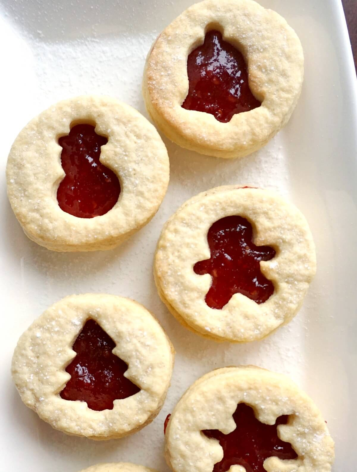 Close-up shoot of 5 linzer cookies on a white plate