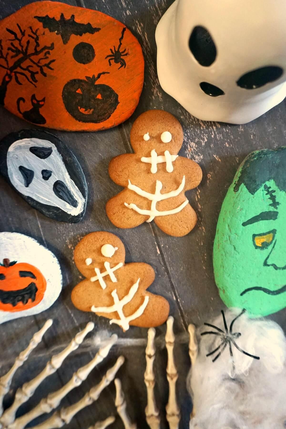 Overhead shoot of 2 Halloween gingerbread men with Halloween decorations around