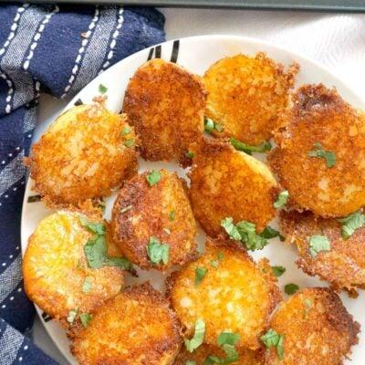 Crispy Roasted Garlic Parmesan Crusted Potatoes