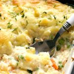 A dish with fish pie topped with mashed potatoes