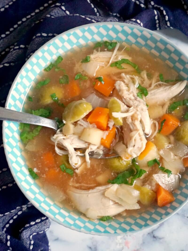 Overhead shoot of a blie bowl of slowe cooker chicken soup