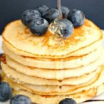 Low Carb Almond Pancakes made with almond flour, fluffy and light, and super easy to make. They are gluten free, keto and low calorie, and they are a great choice for a healthy breakfast or brunch. Serve them with honey, or maple syrup and the fruit of your choice. These almond flour pancakes are a great alternative to the traditional pancakes for Pancake day or any other time, and they go well with the whole family. #almondpancakes, #lowcarb, #ketorecipes, #almondflourrecipes, #breakfast