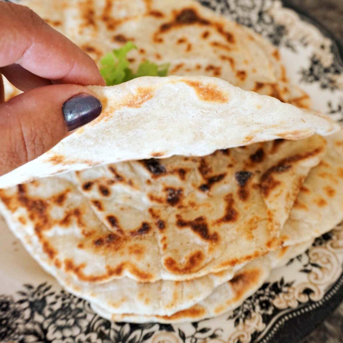 Hand-held flat bread to show thickness