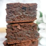 A stack of 2 slices of vegan brownies