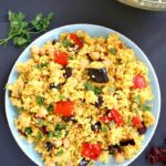 Overhead shoot of a light blue plate with moroccan couscous salad