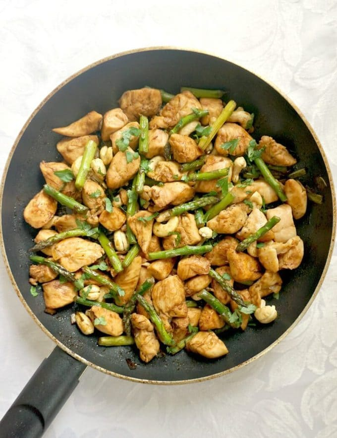 Overhead shoot of a pan with chicken and asparagus stir fry