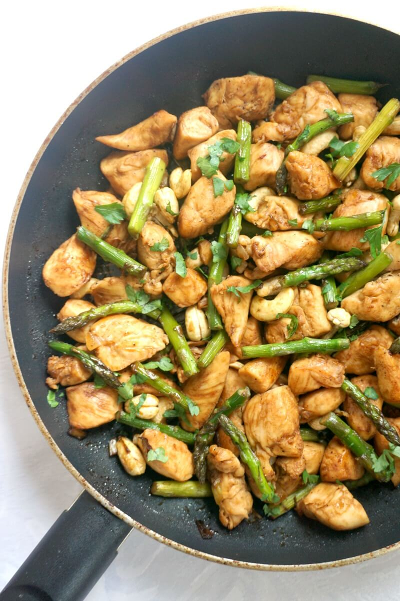 Overhead shoot of half a pan with chicken and asparagus stir fry