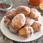 A white plate with beignets