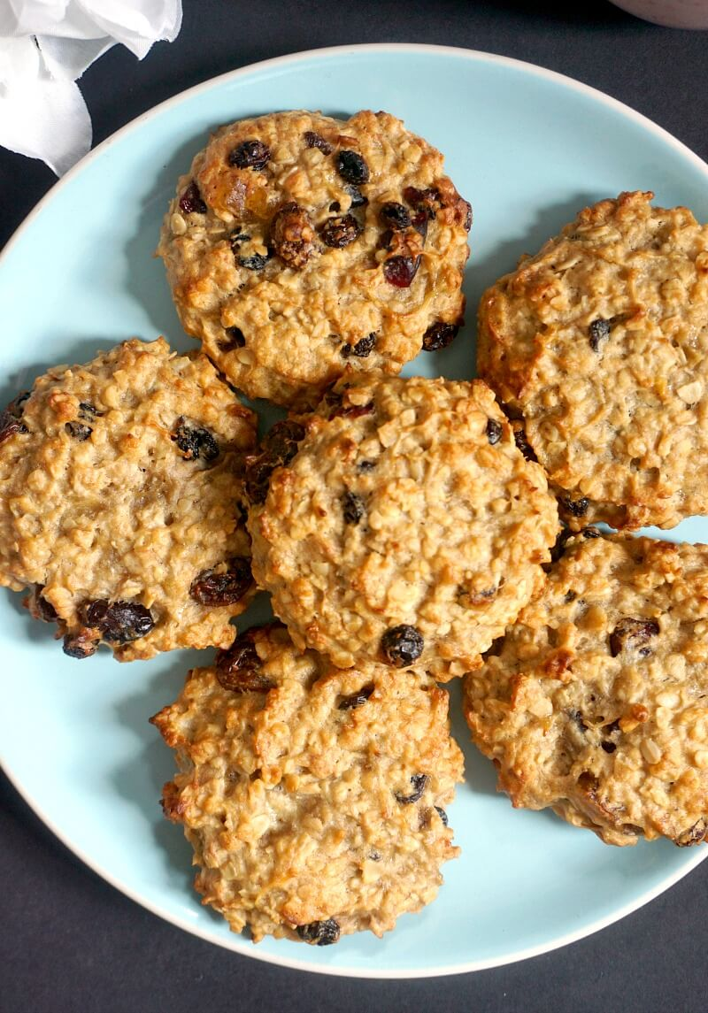 A blue plate with 6 peanut butter oatmeal raisin cookies