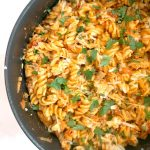 A pan with cheesy chicken pasta