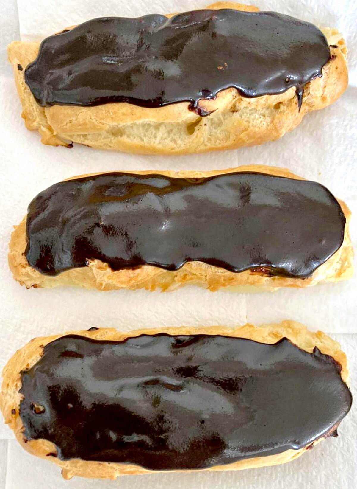 Overhead shoot of 3 chocolate eclairs