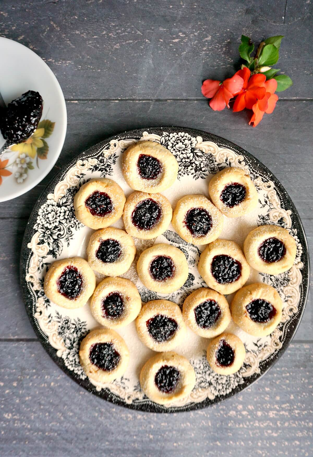 Overhead shoot of a plate with thumbprint cookies filled with jam