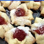Easy Shortbread Thumbprint Cookies filled with jam and sprinkled with vanilla sugar, so soft and buttery, almost melting in your mouth. They are the perfect bite-size treat for every occasion, and a big hit with kids and grown-ups alike.Grab some now, before the cookie monster eats them up! The jam can be any of your choice, and you can use a cookie cutter to give them a nice shape, or not, the taste is all that matters. #thumbprintcookies, #cookies, #dessertrecipes, #dessert