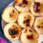 Close- up shoot of a white plate with 7 custard tarts