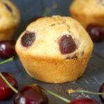 3 cherry muffins with cherries around them