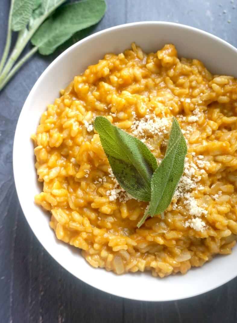 A white plate with pumpkin risotto