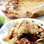 Apple and Plum Crumble, a delicious Fall dessert made with fresh seasonal fruit. This indulgent sweet treat has a hint of cinnamon and lemon, and goes very well with a scoop of ice cream or some custard. Super easy to make, and so indulgent.