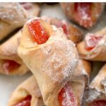 "Bow Tie Cookies filled with jam and Turkish Delight, some delicious cookies that simply melt in the mouth. These are the famous Romanian ""Cornulete"", the cookies the whole nation is crazy about. Super easy to make, and quick too."