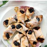 """Bow Tie Cookies filled with jam and Turkish Delight, some delicious cookies that simply melt in the mouth. These are the famous Romanian """"Cornulete"""", the cookies the whole nation is crazy about. Super easy to make, and quick too."""