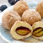 Plum Dumplings, a popular dessert across Eastern Europe. It is made with fresh ripe plums coated in a mashed potato dough and tossed into sweetened cinnamony breadcrumbs. A fantastic Fall recipe that goes well with the whole family.