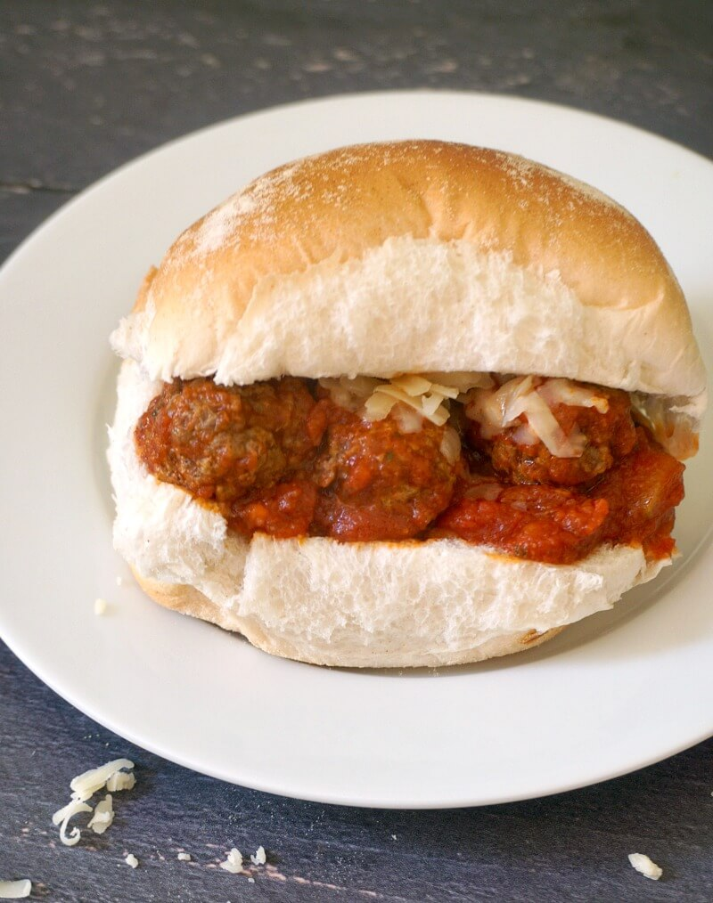 A meatball slider on a white plate