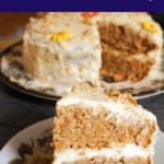 A slice of carrot cake with more cake in the background