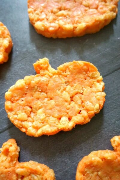 Close-up shoot of a pumpkin-shaped rice krispie treat with other treats around