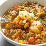 A white bowl with chili with sweet potatoes