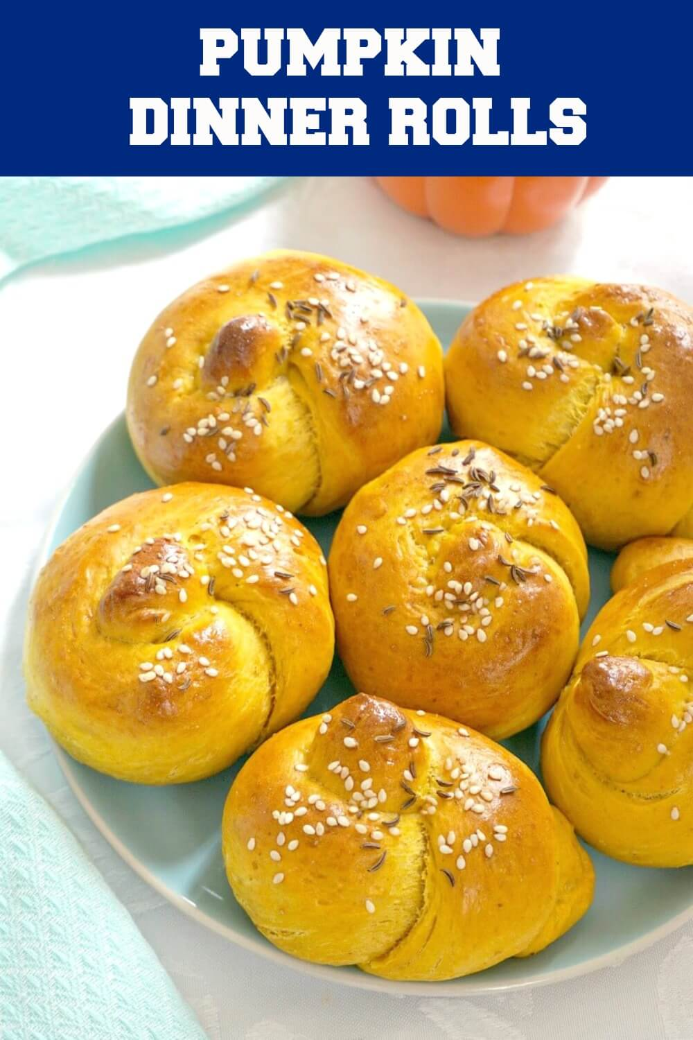 Savoury Pumpkin Dinner Rolls made with canned pumpkin; soft and fluffy, and so easy to make. From little to big tummies, your whole family will be in love with these little pumpkin beauties. Call them pumpkin buns or pumpkin knots, they are absolutely amazing. A great holiday side for your Thanksgiving or Christmas dinner. #homemadedinnerrolls #dinnerrolls #pumpkinrolls #pumpkinrecipe #thanksgivingside , #pumpkin