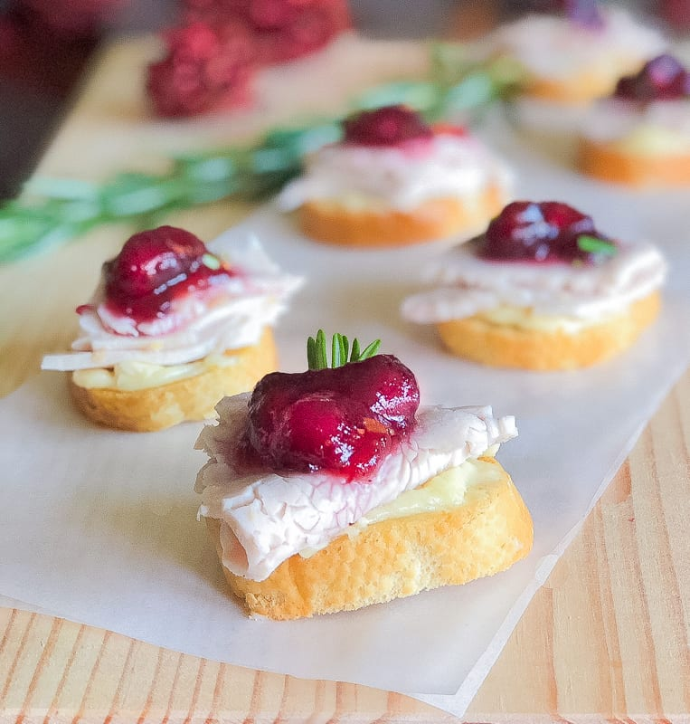 4 turkey crostini topped with cranberry sauce
