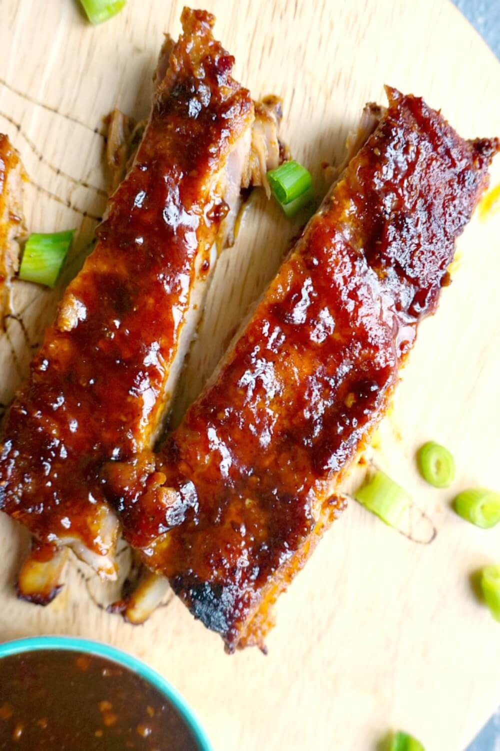 Easy Oven Baked Ribs with Sticky BBQ Sauce, the perfect finger food to feed a crowd. These pork ribs are perfect for Game Day or any other party or celebration. It might be a simple recipe, but these BBQ ribs are heavenly flavourful, and the Asian touch takes them to the very next level. The best ribs for Superbowl, they can be easily made with any other sauce of your choice. #porkribs, #bakeribs, #superbowlfood, #gamedayrecipes,#bbqsauce