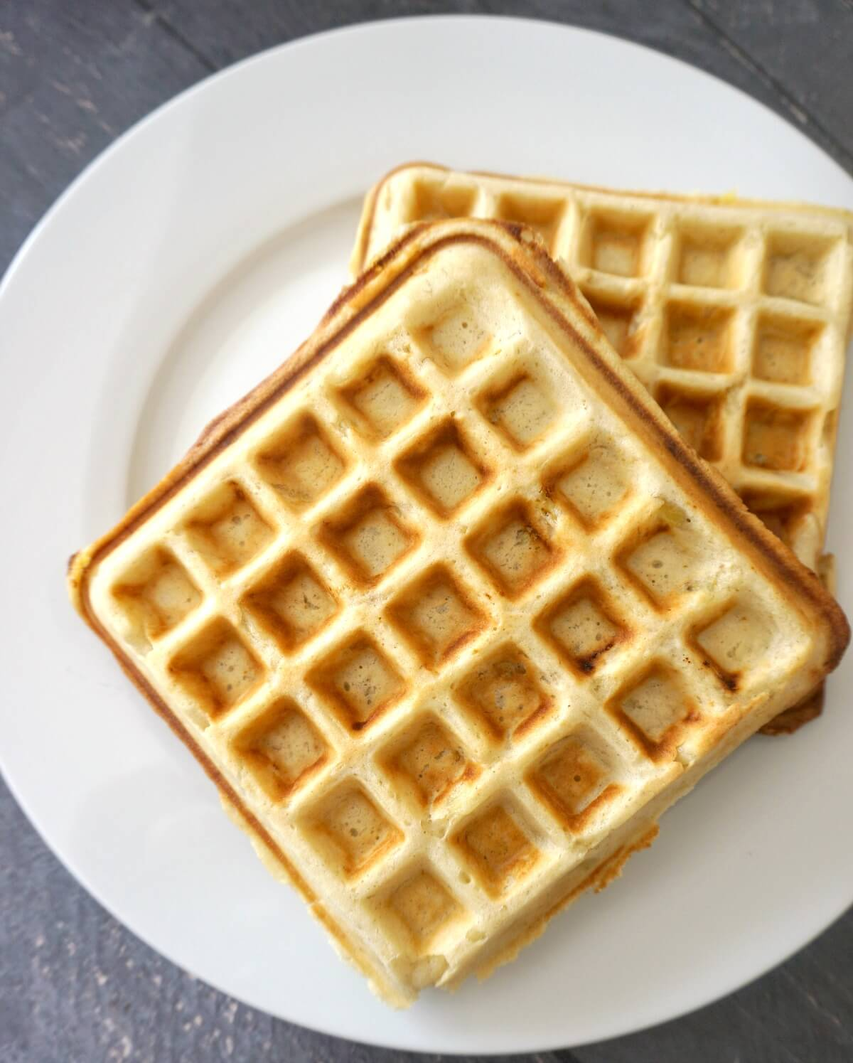 Overhead shoot of 2 waffles on a white plate