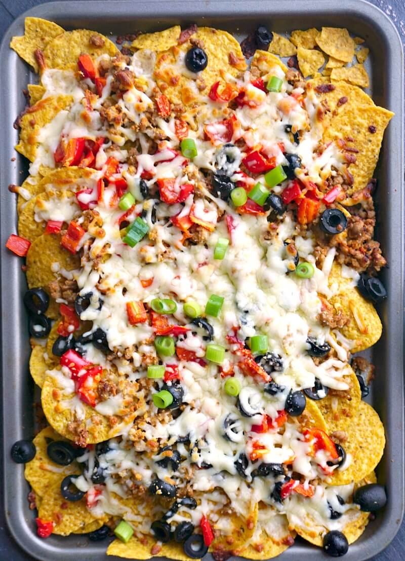 Overhead shoot of a tray with loaded ground pork nachos