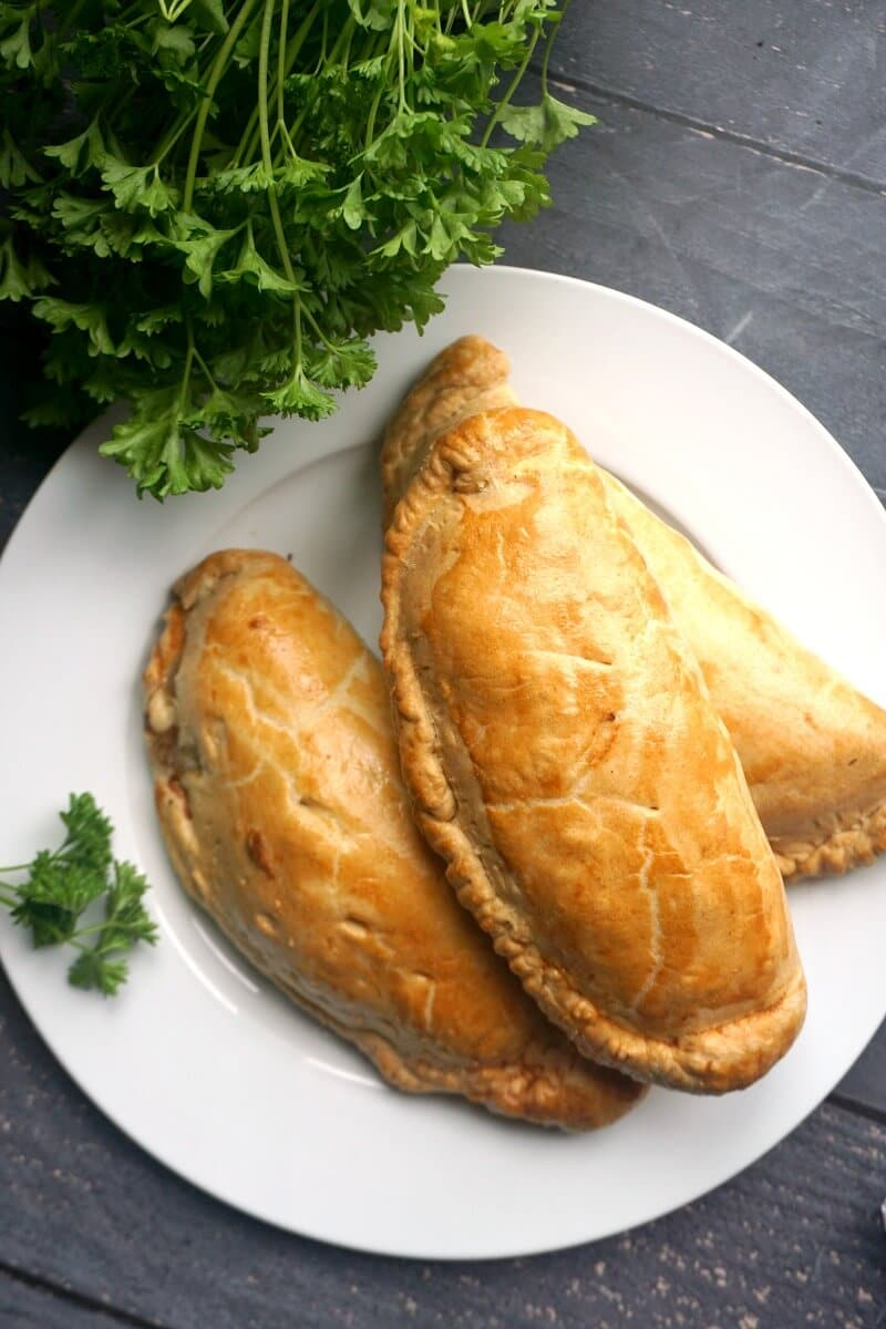 3 Cornish pasties on a white plate