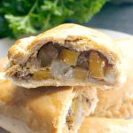 Traditional Cornish Pasties made from scratch with a homemade shortcrust pastry, and filled with the classic diced beef, potato, swede and onion. They are lightly seasoned with salt and pepper, and baked to perfection until the pastry is golden, and the meat and veggies are tender. The nation's favourite pasties, so easy to make at home. The classic Cornish pasty is delicious, and great as a quick lunch or a light meal served on their own or with a salad. #cornishpasties, #cornishpasty, #pasty