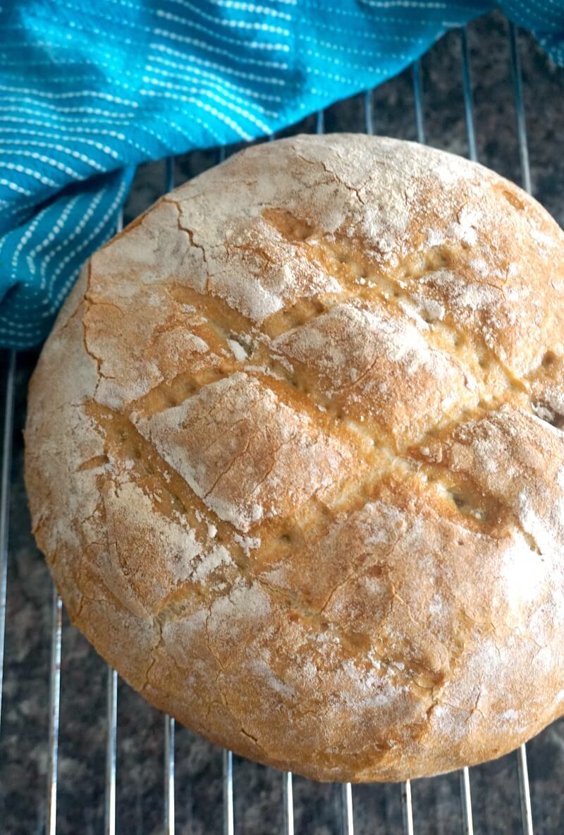 A country bread on a cooling wrack