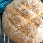 A rustic bread on a cooling rack