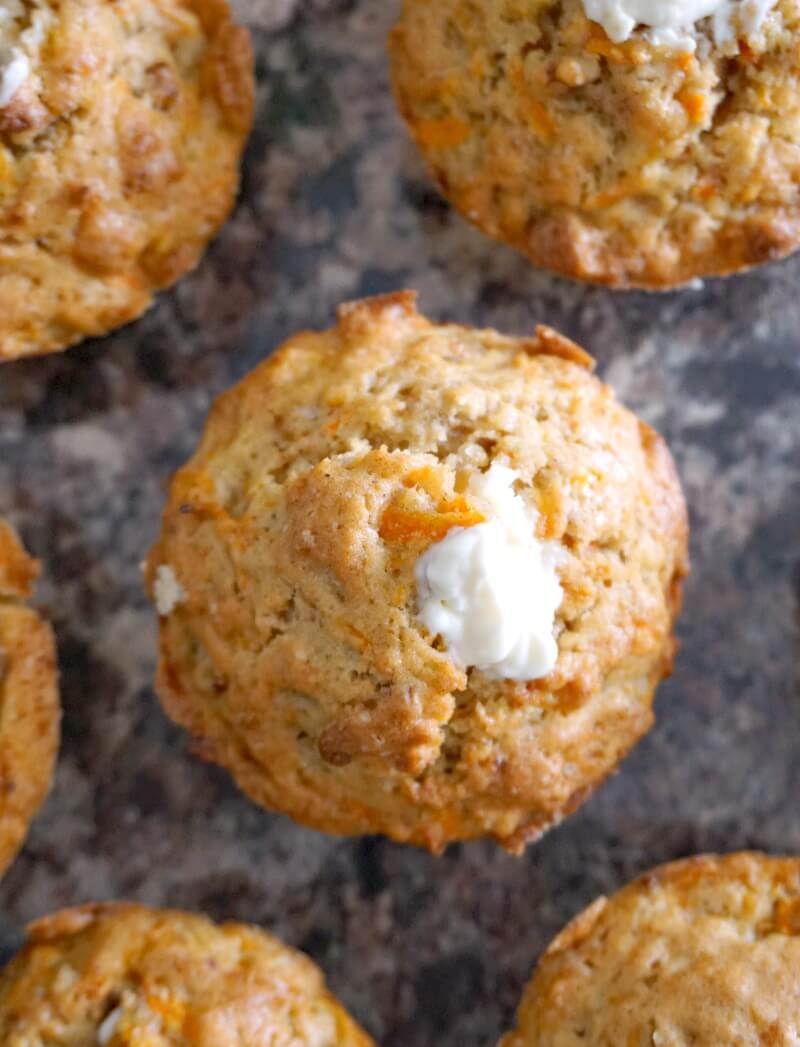 Overhead shoot of a carrot cake muffin surrounded by other muffins