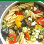 Roasted Vegetable Pasta Salad with Feta and a light honey and lemon dressing, a delicious vegetarian summer recipe that is light, yet filling, and healthy too. It goes well everyone in the fam, and can be enjoyed as a quick lunch, picnic or a light dinner. Absolutely delicious! Roasted peppers, mushrooms, aubergines (eggplant), onion and zucchini (courgettes), but any other vegetables can do. Leave the cheese out, and you get a vegan salad. #pasta, #pastasalad, #roastedvegetables, #summerrecipes