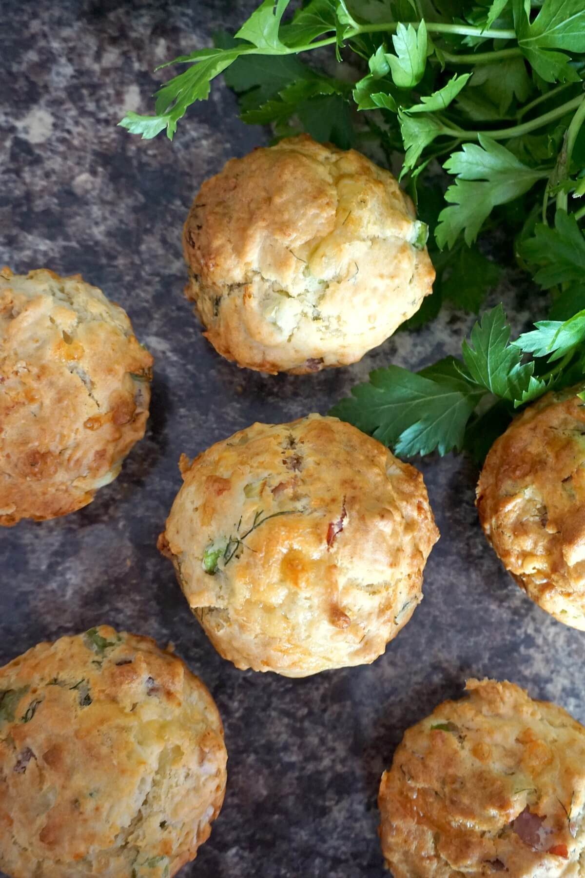Overhead shoot of 6 muffins and fresh parsley