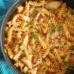 A pot of pasta with chicken